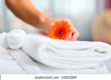 Maid doing room service in hotel, she is making up the beds