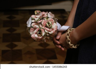 maid of honours bouquet while listening to the vows