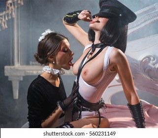 The maid kisses dominant breast