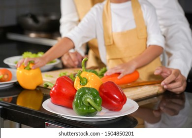 maid prepare vegetable and food material for cooking