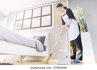 maid young Cleaning mopping in the bedroom