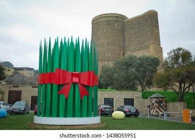 Maiden Tower (Baku). The Maiden Tower also known as Giz Galasi, located in the Old City in Baku, Azerbaijan. Artificial big Semeni. Novruz green fresh semeni.