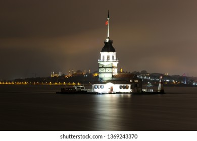 Maiden Tower at Istanbul with Turkish Flag at night. Sultanahmet Mosque, Ayasofya Mosque and Galata Tower are in the background.