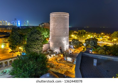 The Maiden Tower also known as Giz Galasi, located in the Old City in Baku, Azerbaijan at night. Maiden Tower was built in the 12th century as part of the walled city.