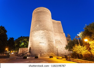 The Maiden Tower at night. It is also known as Giz Galasi and located in the Old City in Baku, Azerbaijan.