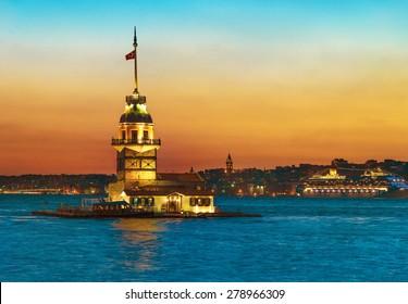 Maiden's Tower (Kiz Kulesi) illuminated at sunset. Istanbul, Turkey