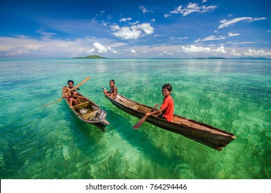 Maiga island, Semporna Sabah - June 7, 2014 : Unidentified Bajau Laut kids playing on the foreground with clear water at Maiga Island Semporna Sabah Malaysia.