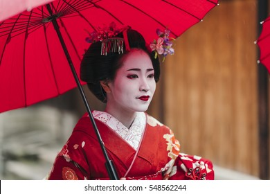Maiko geisha walking on a street of Gion in Kyoto Japan