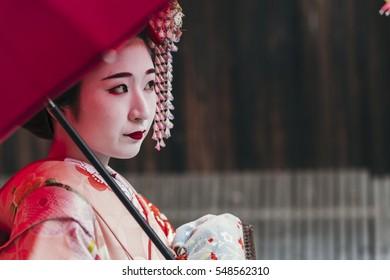 Maiko geisha walking on a street of Gion in Kyoto Japan