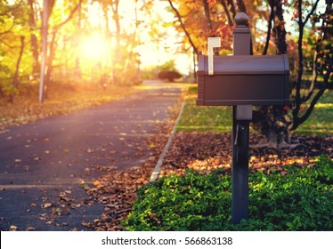 Mail Box in the autumn village. Sunset.