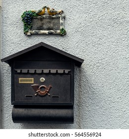 mail box and house number on the wall