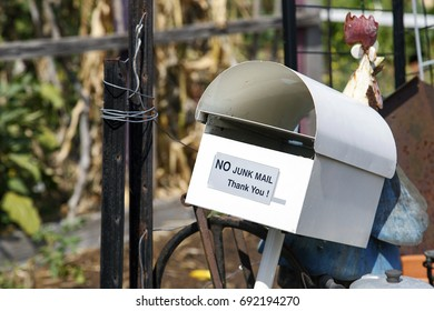 Mail box with a 'No Junk Mail' sign on it.