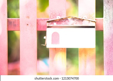 Mail box on fence