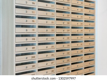 Mail boxes filled of leaflets and letters, Mailboxes and Lock in Rows at Entrance.