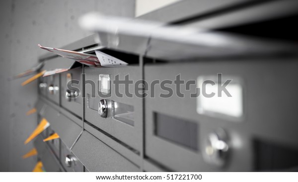 Mail boxes filled of leaflets and letters. Shallow DOF.