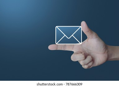 Mail icon on finger over light gradient blue background, Contact us concept