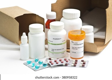 Mail order medication containers with shipping boxes.