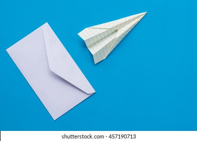 The mail and paper rocket on blue paper color background