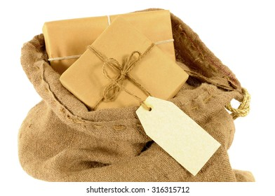 Mail sack or post bag, brown paper packages and blank manila address label