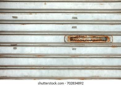 Mail Slot on Folding Metal Door.