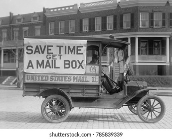 Mail Wagon in Washington, D.C. in 1916. On its side is a large sign encouraging citizens to get mailboxes, allowing mail to be dropped off instead of hand delivered