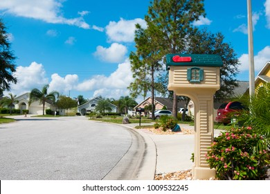 Mailbox in american middle-class neighborhood in summer sunny day with calm lonely street