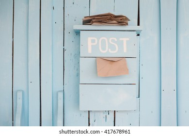 mailbox with letters in vintage style on wooden blue background