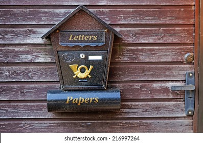 Mailbox on a wooden gate close-up