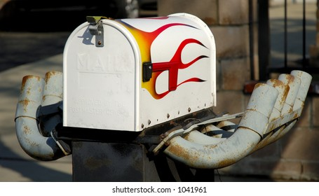 Mailbox with painted flames and exhaust pipes. Concept, fast, speed, speedy postal service.