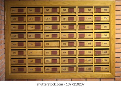 Mailbox for rent With the number window and the code letter locked in the postal background Old wooden cabinet