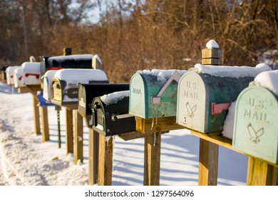 mailboxes in a row with snow and ice