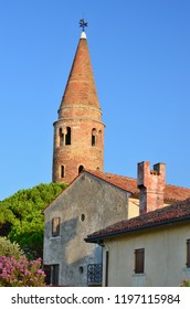 The main art gem of Caorle is the Dome of 1038 with its cylindrical bell tower conical peak, Caorle, Italy