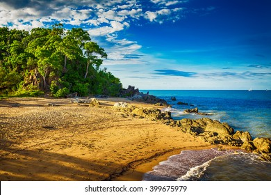 Main beach in Palm cove with rocks and trees during sunset, Australia