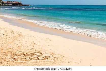 The main beach in Santa Maria, Sal, Cabo Verde, with amazing turquoise sea and golden sandy beach on a sunny day. Cabo Verde is written in the sand.