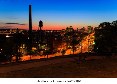 Main and Broad Sts in Richmond Va at dusk from Libby Hill with night lights and streaming cars.