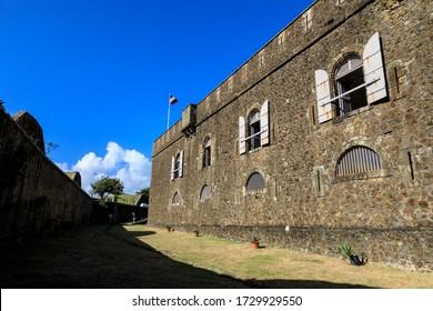 Main building of French Fort Napoleon, behind the shadow of a huge defensive moat, Bourg des Saintes, Terre de Haut, Iles Des Saintes, Les Saintes, Guadeloupe, West Indies, Caribbean 12.04.19