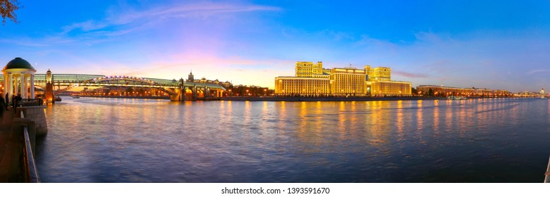 Main Building of the Ministry of Defence of the Russian Federation (Minoboron), at night-- is the governing body of the Russian Armed Forces and Moskva River (panorama). Moscow, Russia