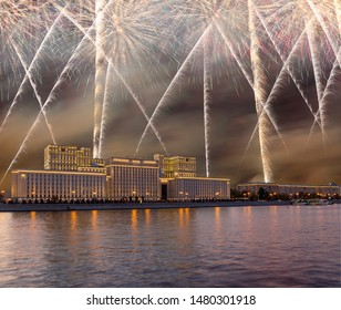 Main Building of the Ministry of Defence of the Russian Federation-- is the governing body of the Russian Armed Forces and celebratory colorful fireworks exploding in the skies. Moscow, Russia
