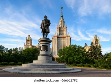 Main building of moscow state university or MSU and close perspective of monument to greatest russian scientist Lomonosov with blooming flowers, green trees, blue sky. Education in Russia, Moscow