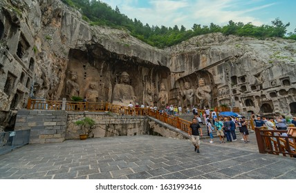 The main cave (Fengxiangsi Cave) of Longmen Grottoes in Luoyang, . A major Buddhist caves of China, a world heritage Site in Henan, China -  07/29/2018