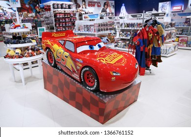 """Main character of the cartoon """"Cars"""" - McQueen racing car, nicknamed"""" Lightning"""", from the Walt Disney store in The children's world. Moscow. 14.12.2018"""