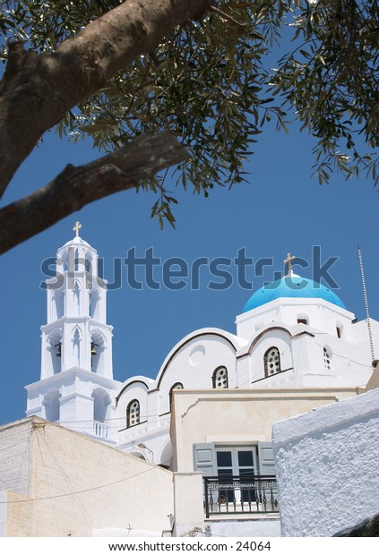 The main church at Pyrgos, Santorini, seen from under an old olive tree.