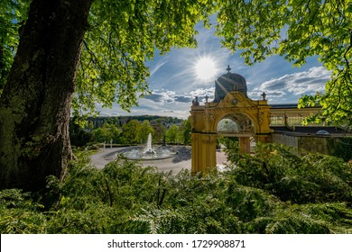 Main colonnade and Singing fountain in small spa town Marianske Lazne (Marienbad) - Czech Republic - Shutterstock ID 1729908871