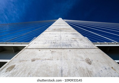Main concrete mast of Megyeri Bridge spanning over River Danube by Budapest, Hungary, seen from below up