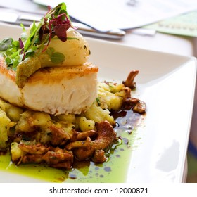 A main course meal featuring Pacific Halibut and baby spinach.