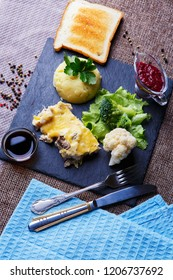 Main dish of mushroom julienne with cheese and rice. Served with soy sauce and greens
