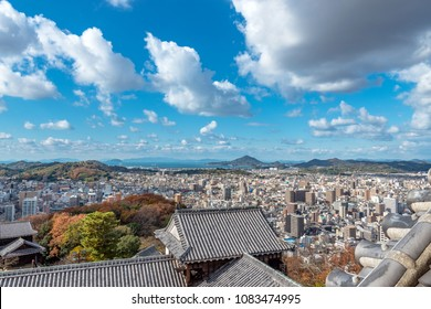 Main enclosure of Matsuyama-jo castle and Cityscape of the Matsuyama city in Japan