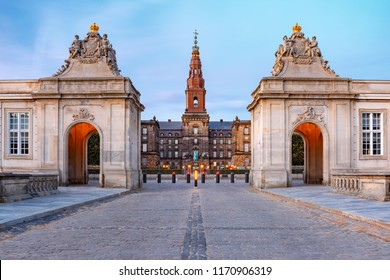 The main entrance to Christiansborg with the two Rococo pavilions on each side of the Marble Bridge during morning blue hour, Copenhagen, capital of Denmark