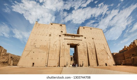 The main entrance of Edfu Temple showing the first pylon, Dedicated to the Falcon God Horus, Located on the west bank of the Nile, Edfu, Upper Egypt