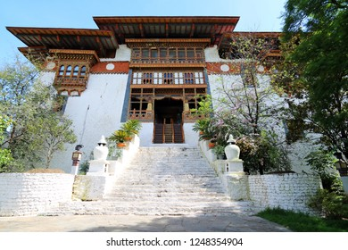 Main entrance to the first pylon of Punakha Dzong, built in 1637, in the fertile Punakha Valley of the Kingdom of Bhutan, basking in the afternoon sun